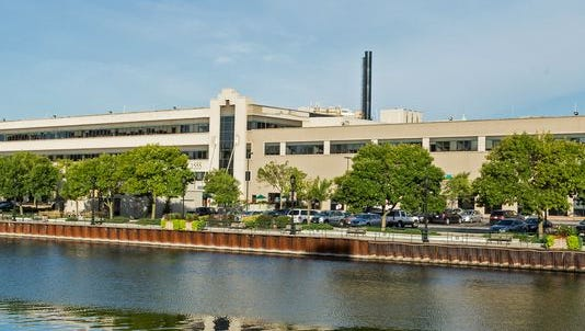 Downtown office park Schlitz Park has been sold to a group of out-of-state investors.
