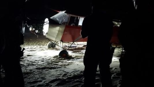 Jimmy Dahlen Jr., the pilot who illegally landed a single-engine plane on a Coast Guard beach,  has turned himself in.