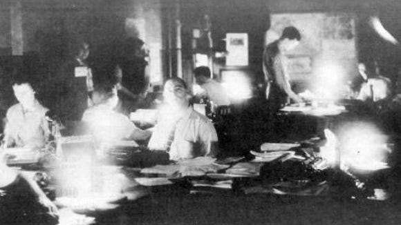 The Gazette and Daily staff work without electricity in the aftermath of Hurricane Hazel's wrath in 1954.