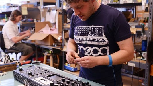 A scene from the Moog Music factory.