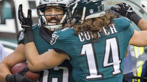 Eagles tight end James Casey (left) celebrates his TD with Bradley Cooper in the third quarter of Sunday's game at Lincoln Financial Field.