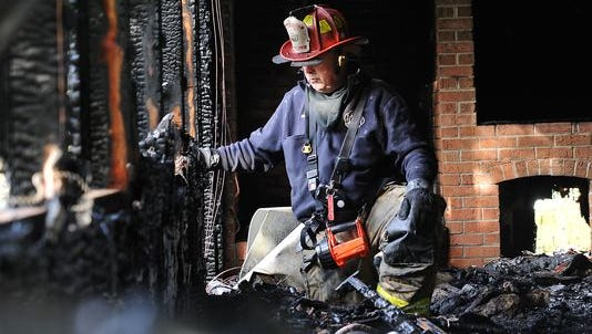 Fire broke out again at 323 E. Oak Street in Millville about 3 a.m. Monday. Captain Doug Hallquist investigates the scene where a fire first damaged the vacant home last week.