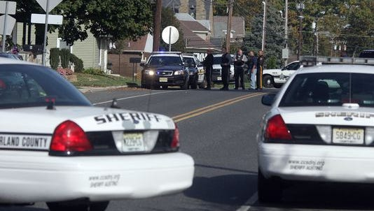 Cumberland County Sheriffs and police from Newfield and Franklin respond to a situation on Catawba Ave. in Newfield, between S. East Blvd. and Church St., Tuesday, Oct. 28, 2014.