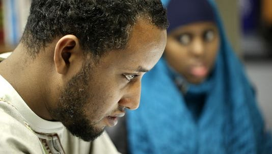 Muhamed Maow, one of 24 Somali Muslims fired by DHL Global Mail, Hebron, in October 2013, is part of a settlement announced Thursday. He is a U.S. citizen and was one of three full-time workers involved in the case. The workers said they were fired for insubordination for saying evening prayers.