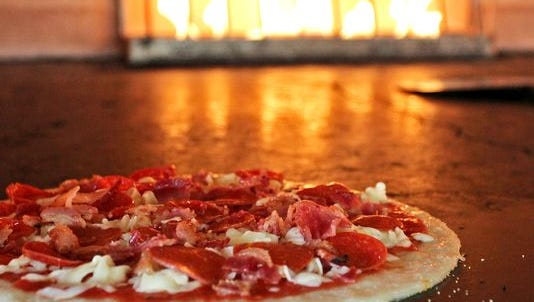 Pizzas at Pieology are cooked for three minutes in a stone oven.