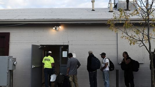 Men line up for a place to sleep at Fort Collins Rescue Mission on Sept. 23. Fort Collins city officials are considering establishing a temporary homeless shelter in Old Town to serve women who have no place to stay this winter.
