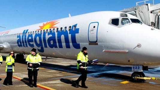 Ground crew members disperse after preparing an Allegiant Travel Company MD-82 jet for departure. The low-cost carrier has the highest complaint rate of any airline flying out of Cincinnati/Northern Kentucky International Airport.