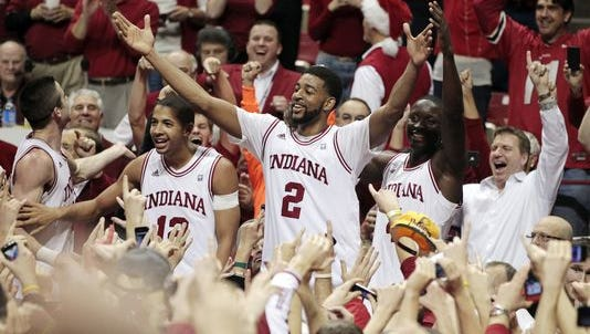 Indiana's deal with Adidas states that if it does not still have the company's eighth-ranked contract after four years, it will be elevated to that level. Here, Hoosier players celebrate after Indiana defeated Kentucky in 2011.