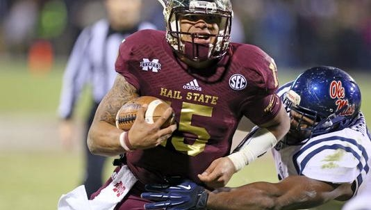 Mississippi State quarterback Dak Prescott breaks off a run in the 2013 Egg Bowl.