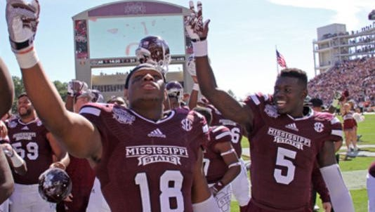 Mississippi State's Brandon Hill (18) and Fred Brown celebrated a win at Davis Wade Stadium.