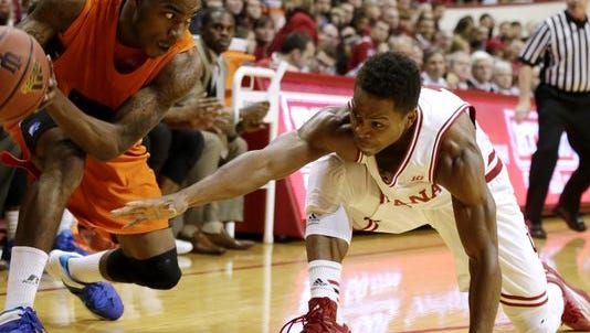 Indiana guard Yogi Ferrell, right, tries to steal the ball away from Savannah State's Terel Hall (22) during a NCAA men's basketball game on Saturday, Dec. 6, 2014, at Assembly Hall in Bloomington.