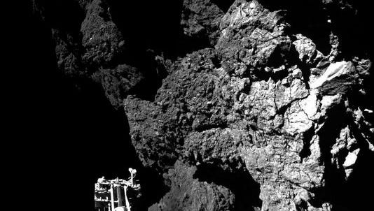 Combination photo released by the European Space Agency on Thursday shows the lander Philae on the surface of Comet 67P/Churyumov-Gerasimenko.