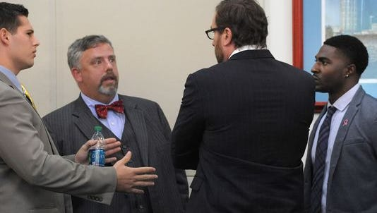 Attorneys Fletcher Long and Worrick Robinson talk with defendants Brandon Vandenberg, left, and Cory Batey, far right, during a motions hearing Oct. 8 in Nashville.