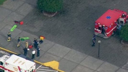 Emergency personnel as seen from a helicopter above shooting scene at a high school in Washington.