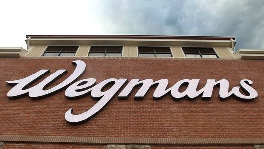 Wegmans sign looms over the entrance of the East Avenue store.