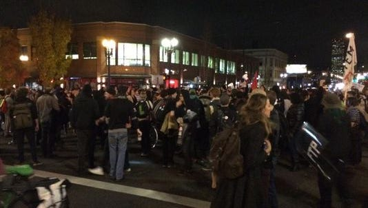 A group of protesters clash with police in Portland Tuesday night.