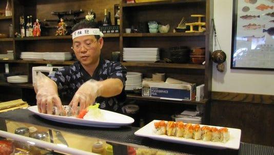 Paul Sze prepares food at Tokyo Japanese Cuisine on South Louise Avenue. (Rob Swenson/SFBJ/ May 2011)