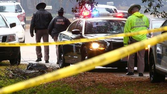 Authorities arrive Saturday to the Plantation Woods neighborhood, where a man killed a Leon County Sheriff's Office deputy.