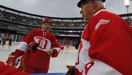 Gordie Howe visits with son Mark at last winter's alumni game in Comerica Park.