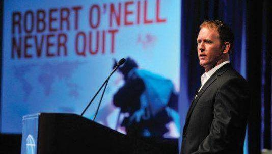 Navy SEAL Rob O'Neill talks at the Greater Green Bay (Wis.) Chamber's annual dinner.