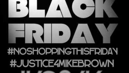 A sign displays the hashtags #NoShoppingThisFriday and #Justice4MikeBrown.