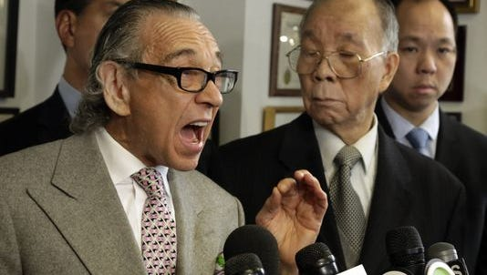 Attorney Sanford Rubenstein, left, during a news conference in New York earlier this year. Rubenstein is accused of sexually assaulting a woman after attending a birthday party for the Rev. Al Sharpton.