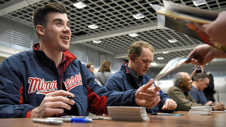 Former Twins players Kent Hrbek  and Tony Oliva sign autographs and talk with fans during the Twins Caravan stop Thursday, Jan. 21 at the River's Edge Convention Center.