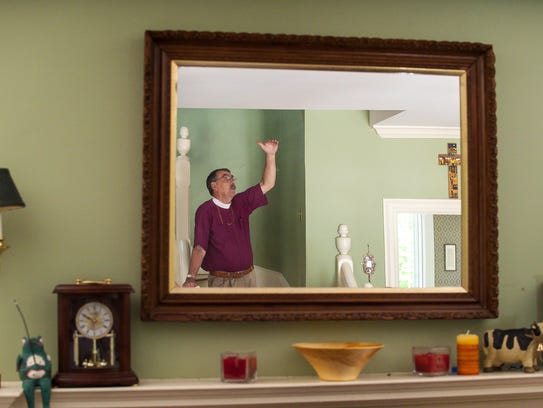 Episcopal Bishop Tom Ely gives a tour of his home at