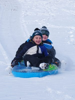 Danny Monsen and Nicholas Evans, both 7, sled at Rockford Park in Wilmington earlier this year.