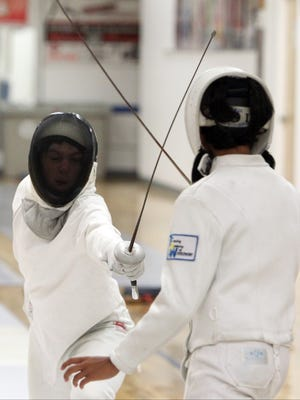 Orlov, 11, of Armonk, left, and J.T. Ball, 12, of Bronxville practice with foils during a summer fencing camp at the Fencing Academy of Westchester in Hawthorne Aug. 8, 2016.