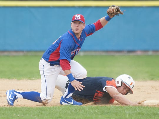 Washington Township shortstop Ryan Swift looks for the call after tagging out Nick Grotti of Millville at second base in the first inning of Monday's nonleague game.