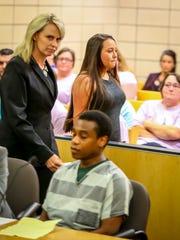 Melisa White, mother of Selena White, walks by Calvin