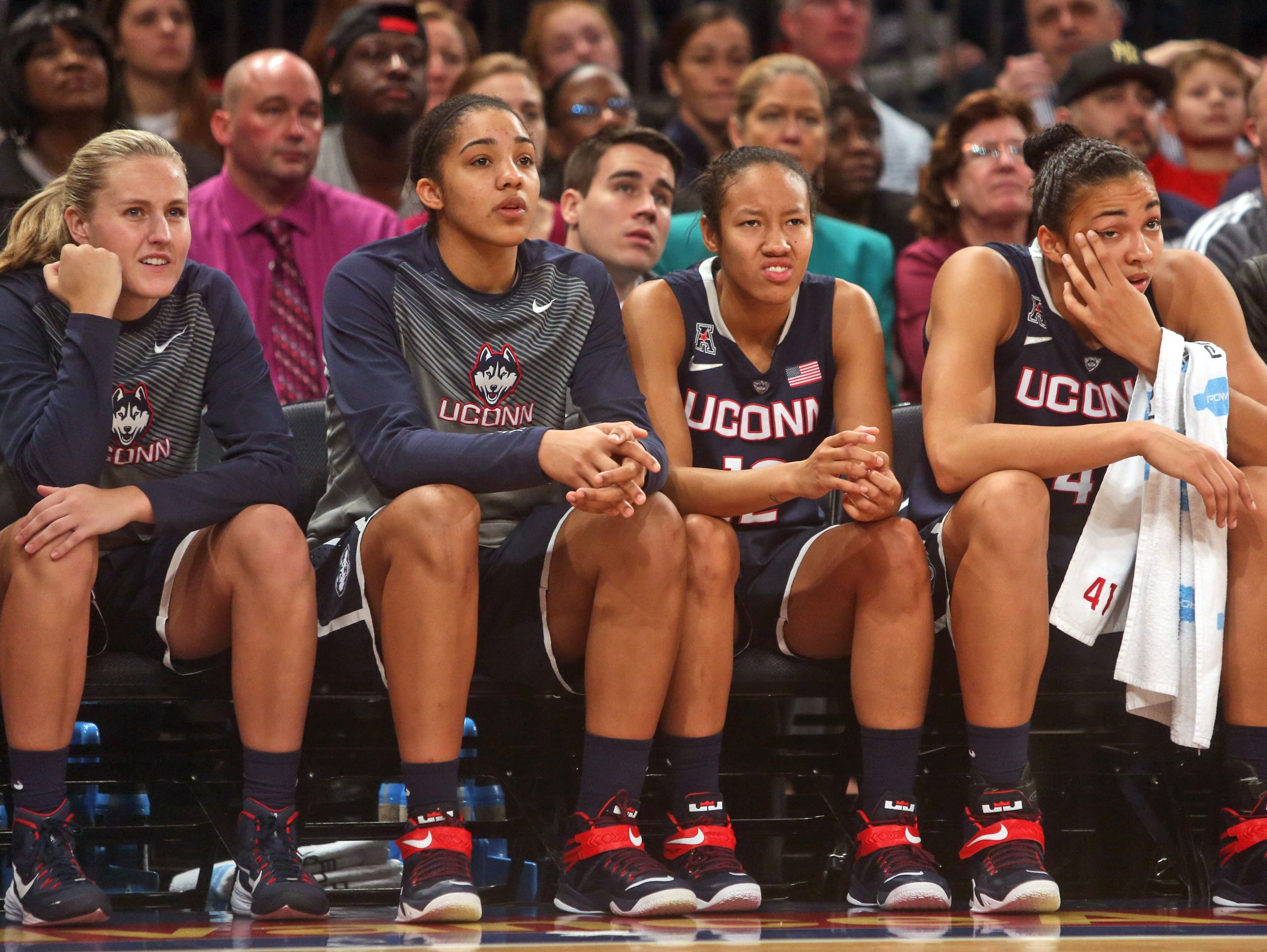 UConn's Saniya Chong, a Peekskill native, second from right, saw limited playing time during a game against St. John's during the Maggie Dixon Classic women's basketball tournament at Madison Square Garden Jan. 4, 2015. UConn defeated St. John's 70-54.