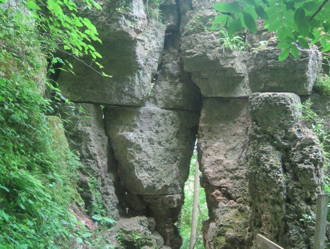 The trail to Treasure Cave in Wyalusing State Park leads through a rock crevice.