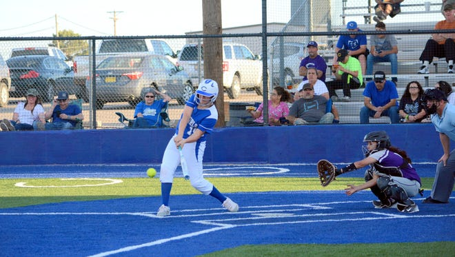 Carlsbad's Taighen Whitzel makes contact for a double in game one Friday against Clovis.