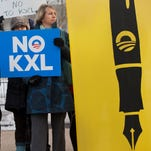 People demonstrate against the Keystone XL pipeline outside the White House in Washington, D.C., on Tuesday