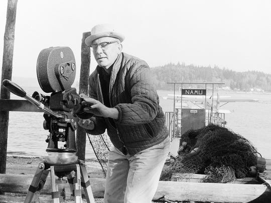 "Cameraman Jack Morrow prepares to shoot a scene for the movie ""Namu, the Killer Whale"" in a Rich Passage Cove in 1966."