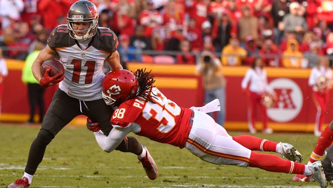 Tampa Bay Buccaneers wide receiver Adam Humphries (11) runs past a tackle attempt by Kansas City Chiefs defensive back Ron Parker (38) during the second half of an NFL football game in Kansas City, Mo., Sunday, Nov. 20, 2016. (AP Photo/Charlie Riedel)