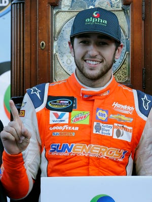 Chase Elliott celebrates his win at Martinsville Speedway, where he took the lead with 17 laps remaining.