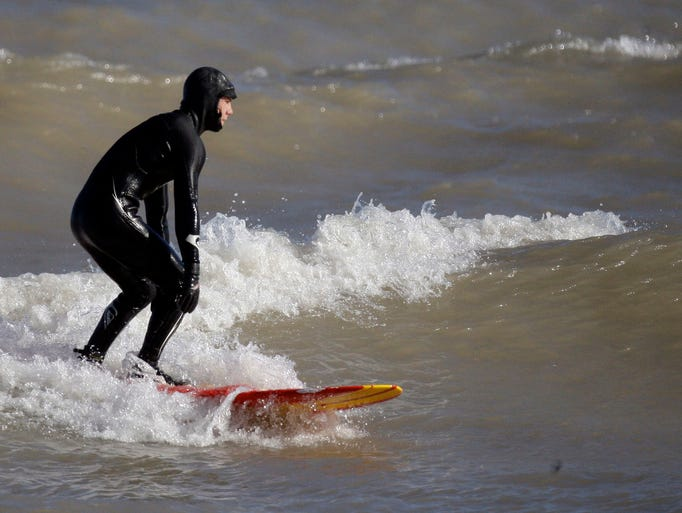 Ben Brotz of Sheboygan goes catches a wave on Lake