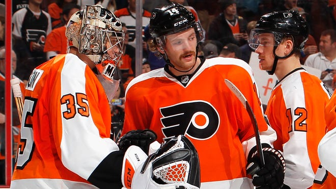 Goalie Steve Mason and Sean Couturier both practiced with the team Monday, the first one after the All-Star break.