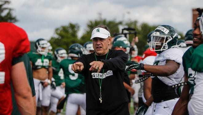 Michigan State football Mark Dantonio instructs his players during practice. Dantonio and the Spartans are entering a critical bounce-back season.