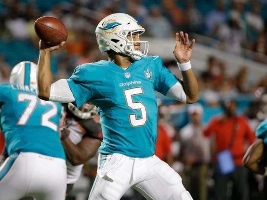 Miami Dolphins quarterback Josh Freeman (5) looks to pass during the second half of an NFL preseason football game against the Tampa Bay Buccaneers, Thursday, Sept. 3, 2015, in Miami Gardens, Fla. (AP Photo/Wilfredo Lee)