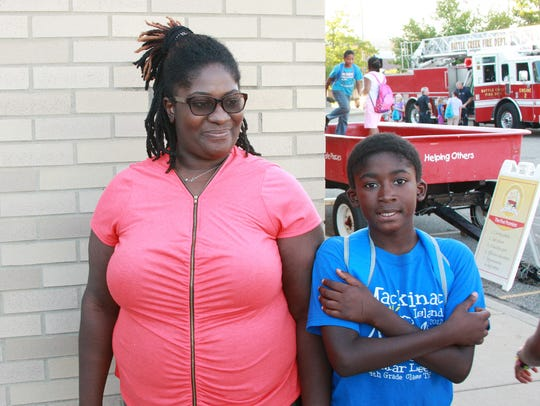 Tiffany Isom and her son, Mikal McCormick, 10, talk