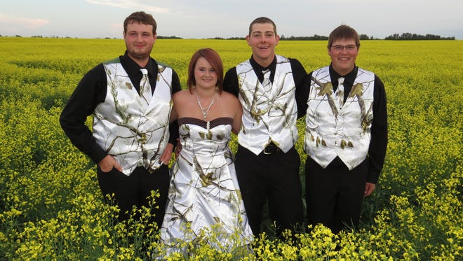 Canadian high school prom-goers show off their outfits from Camo Formal of Tioga.