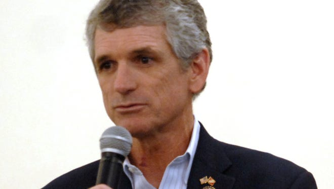 U.S. Rep Scott Rigell addresses a large crowd during a town hall meeting at Little Italy Restaurant in Nassawadox, Va. Rigell announced he will not seek reelection for a fourth term in office.