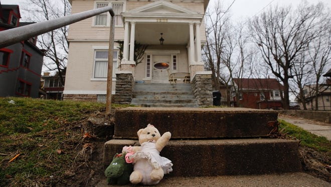 A small memorial has started forming at the 2235 Burnet Avenue in Mount Auburn where a 9-year-old girl was fatally shot Wednesday evening. The girl's father was also struck. Police are searching for three or four suspects.