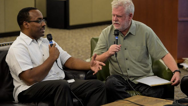 """David Dye, host of NPR's """"World Cafe"""" radio program, right, interviews Herman Fuselier, food and culture editor of the Daily Advertiser, in Lafayette, La., Wednesday, Oct. 29, 2014.  Paul Kieu, the Advertiser"""