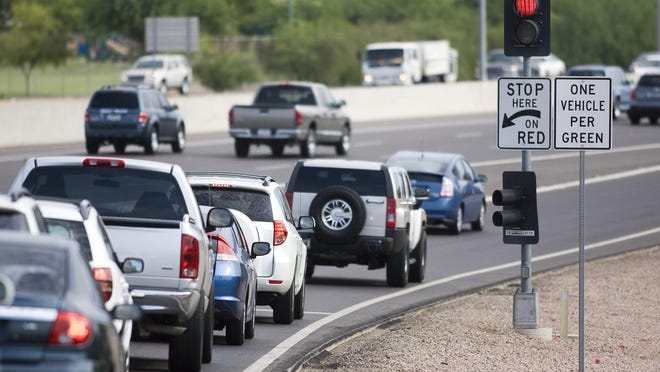 A stop-and-go light directs traffic in the westbound lanes of Interstate Highway 10 at Ray Road in the Phoenix metro area.