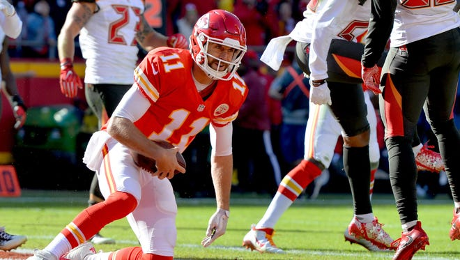 Kansas City Chiefs quarterback Alex Smith (11) scores a touchdown against the Tampa Bay Buccaneers during the first half at Arrowhead Stadium.